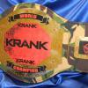 This stock belt was customized for KRANK and is on a camouflage strap with gold plates. The red and gold really work well together with the black lettering on this custom championship replica belt