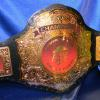 pizza hut custom championship title belt by proambelts. This emperor stock belt and the gold vinyl images and letters really help this belt stand out as a fan favorite