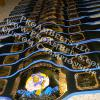 wrestling tournament for each weight class for high school with deep etching and great craftsmanship on the belts, blue trim and black leather strap made these custom championship wrestling belts a huge success for the tournaments