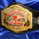Torchy's Taco custom championship title belt was given away in 2014 to the taco eating champion. This double layer thick heavy metal belt was seen around the world and was a huge success for Torchy's Tacos