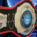 Guinness world records custom championship title belt designed and made by proambelts to honor the most consecutive kicks to one's forehead and this dual stacked metal belt is a sure way to recognized a world recorder holder!