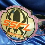 Fully custom belts we can make just about any color strap. This is for a female mma championship on a purple strap.